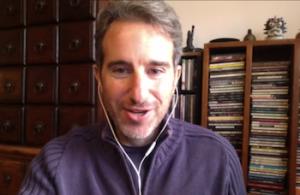 A screenshot of pianist Aaron Goldberg